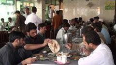 Pakistan restaurant, lunch time, fresh food, busy, crowded, people, customers - stock footage