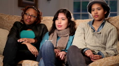 Happy young women on the couch Stock Footage
