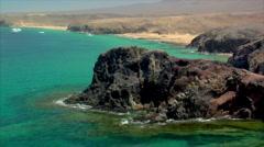 Famous lanzarote papagayo beach rocks close Stock Footage