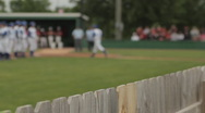 Baseball players and coach running out to field, crowd in the background Stock Footage