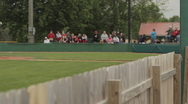 Small crowd at baseball game - Focus pull Stock Footage