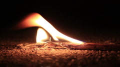 Rekindle (pouring denatured alcohol on a burning twig) - stock footage