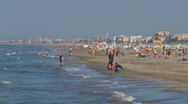 Stock Video Footage of People relaxing and walking on the beach,  Rimini, Italy,