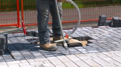 construction, paving bricks spacing with crowbar - stock footage