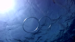 Bubble ring joining each other Stock Footage
