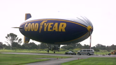 Locked off shot of Good Year Blimp's starboard side Stock Footage