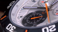 Stock Video Footage of two second hands on a chronograph working together, crossing each other