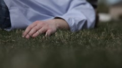 Dead body laying in a field of grass 1 Stock Footage