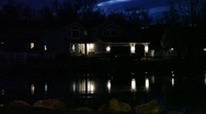 Stock Video Footage of Lake House Reflection at night on water