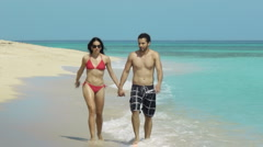 Husband and wife holding hands near Caribbean sea Stock Footage
