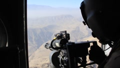 Military Shooting Out of Helicopter (HD) c Stock Footage
