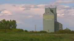 Agriculture, old grain wooden elevator, working and prairie Stock Footage