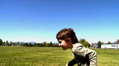 little boy running outside - stock footage