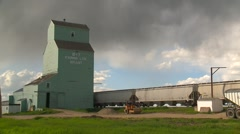 Agriculture, old grain wooden elevator, working, with rail cars Stock Footage