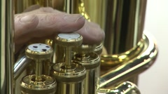 Cu male fingers golden trombone Stock Footage