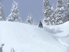 Skier skiing down powder Stock Footage