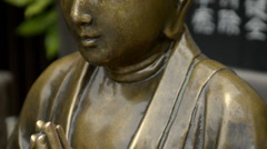 Iron Buddha statue in Asakusa zooming out Stock Footage