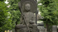 Stone Buddha statue in Asakusa zooming out Stock Footage