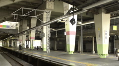 Passengers entering a train in Tokyo Stock Footage