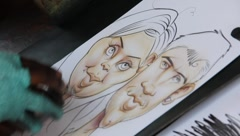 caricature drawing of a couple in love 3 - stock footage