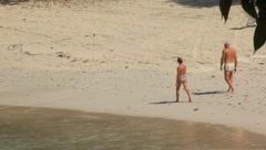 Couple Walking Along Beach Shore Line (HD) c Stock Footage
