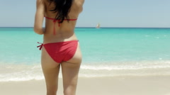 Pretty young latina woman with red swimsuit on the beach Stock Footage