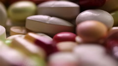 spinning pills in a loop - stock footage
