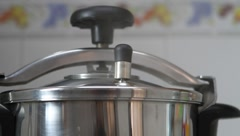 Pressure cooker and weight Stock Footage