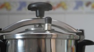 Stock Video Footage of Pressure cooker and weight