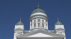Evangelical Lutheran cathedral Helsinki Finland white church facade blue sky day Stock Footage