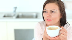 Beautiful brunette woman enjoying a cup of coffee Stock Footage