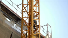 Worker Climbs Crane  . FULL HD  Stock Footage