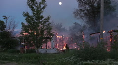 House fire full moon night P HD 9203 Stock Footage