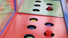 Whack-a-mole game whack a mole theme park - stock footage