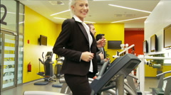 Businesswoman in gym dolly shot Stock Footage