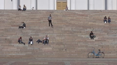 People relaxing on steps of Evangelical Lutheran Cathedral Helsinki, Finland Stock Footage