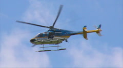 131 Police Helicopter Flying with Secret Service Agents protecting the President Stock Footage