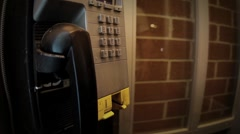 Dialling a Dirty Pay Phone - stock footage