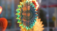Colorful spinning rainbow SUN ornament mobile HOT CLOSEUP Stock Footage