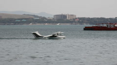 Small hydroplane floating in the port bay Stock Footage