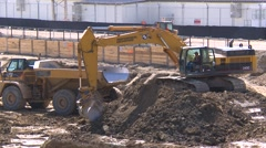 construction, backhoe and large dumptruck - stock footage