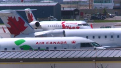 Aircraft, jets being tugged to and from gates, long shot Stock Footage