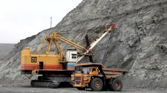 Loading gold ore in a body of 140-ton truck Stock Footage