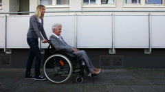 Disabled woman in wheelchair Stock Footage