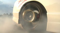 Tire burnout with a high performance nissan skyline Stock Footage