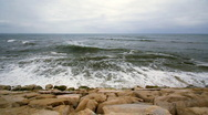 Slow motion waves on rocky coast Stock Footage