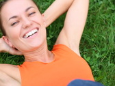 Young happy woman lying on the grass, top view, slow motion NTSC Stock Footage