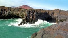 Los hervideros vulcan lava cave wave Stock Footage