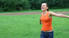 Happy excited woman turning around on meadow, slow motion, steadicam shot HD - stock footage