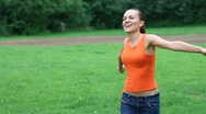 Happy excited woman turning around on meadow, slow motion, steadicam shot HD Stock Footage